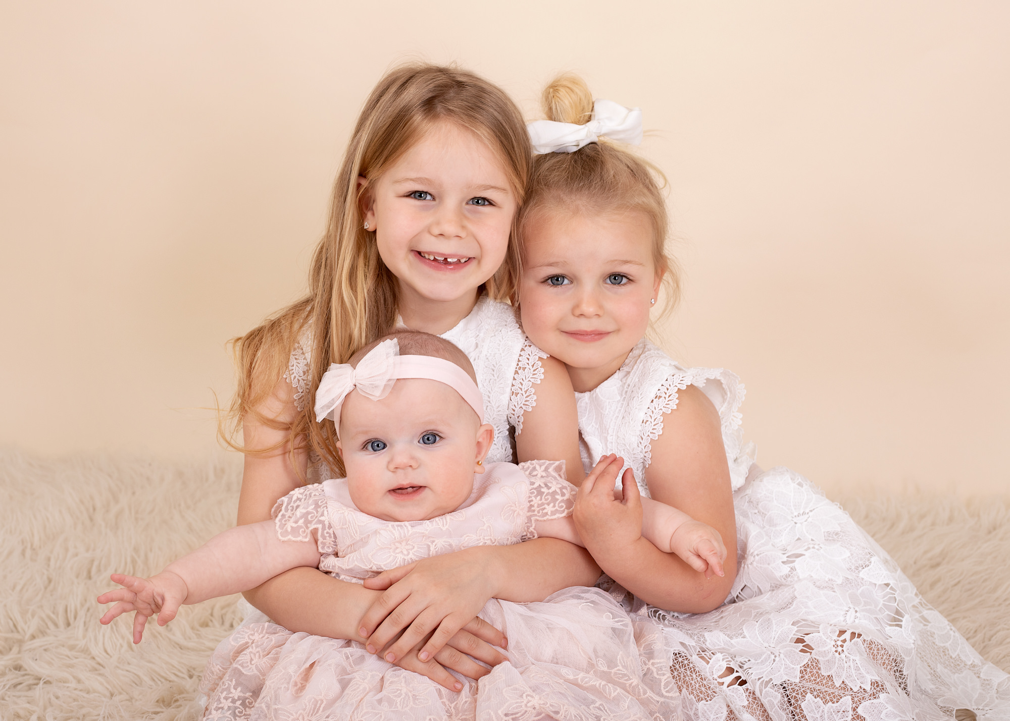 A family of 3 sisters in beautiful dresses photographed in Kent