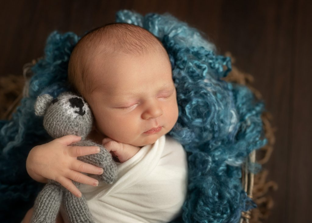 newborn baby boy with teddy bear
