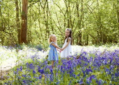 sisters in a bluebell wood