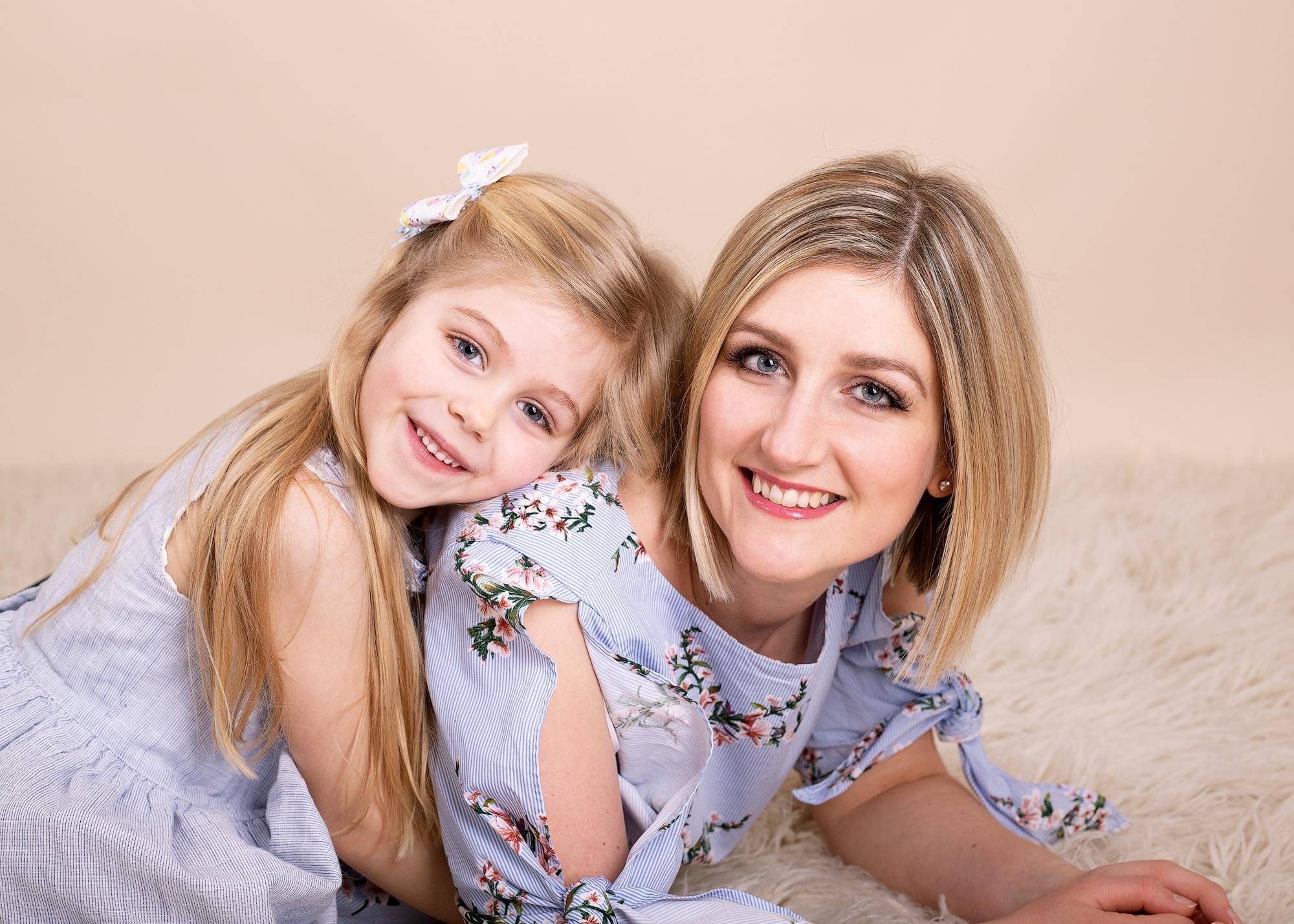 daughter cuddling mum photographed in Kent