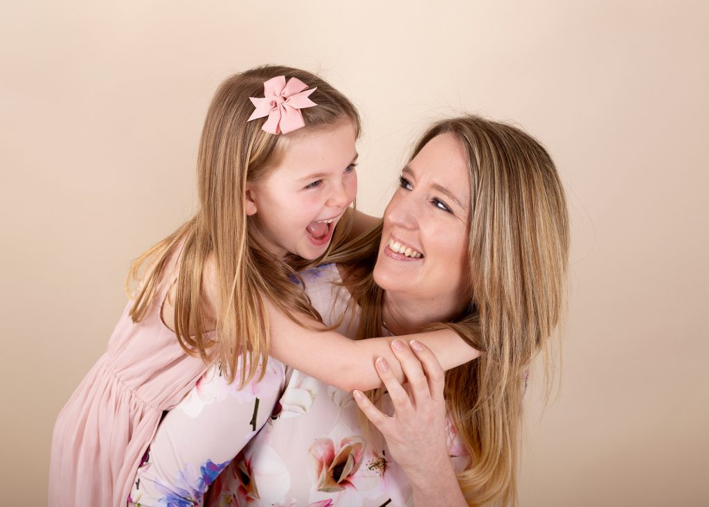 mum and daughter laughing