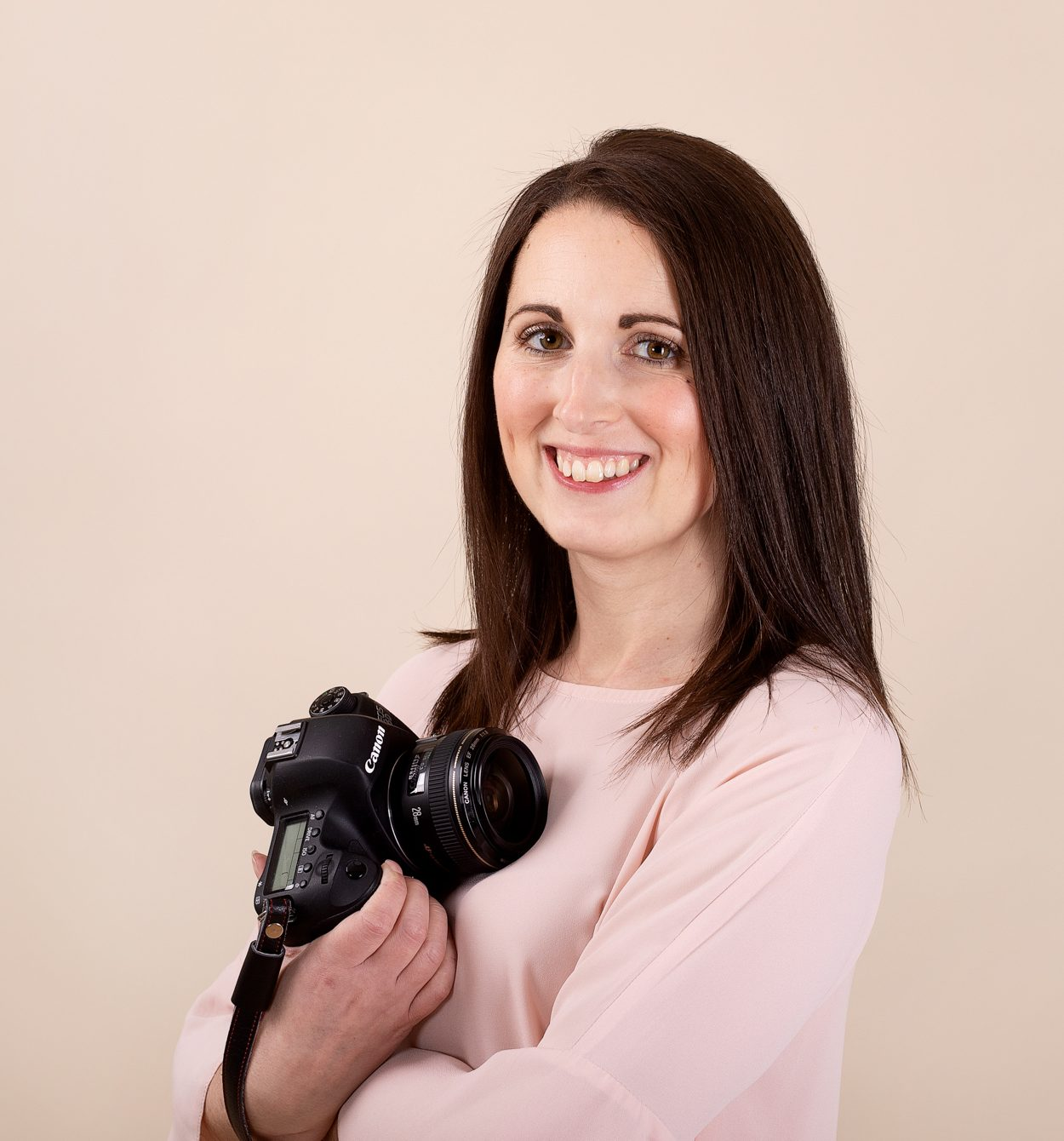 family photographer holding camera in Kent