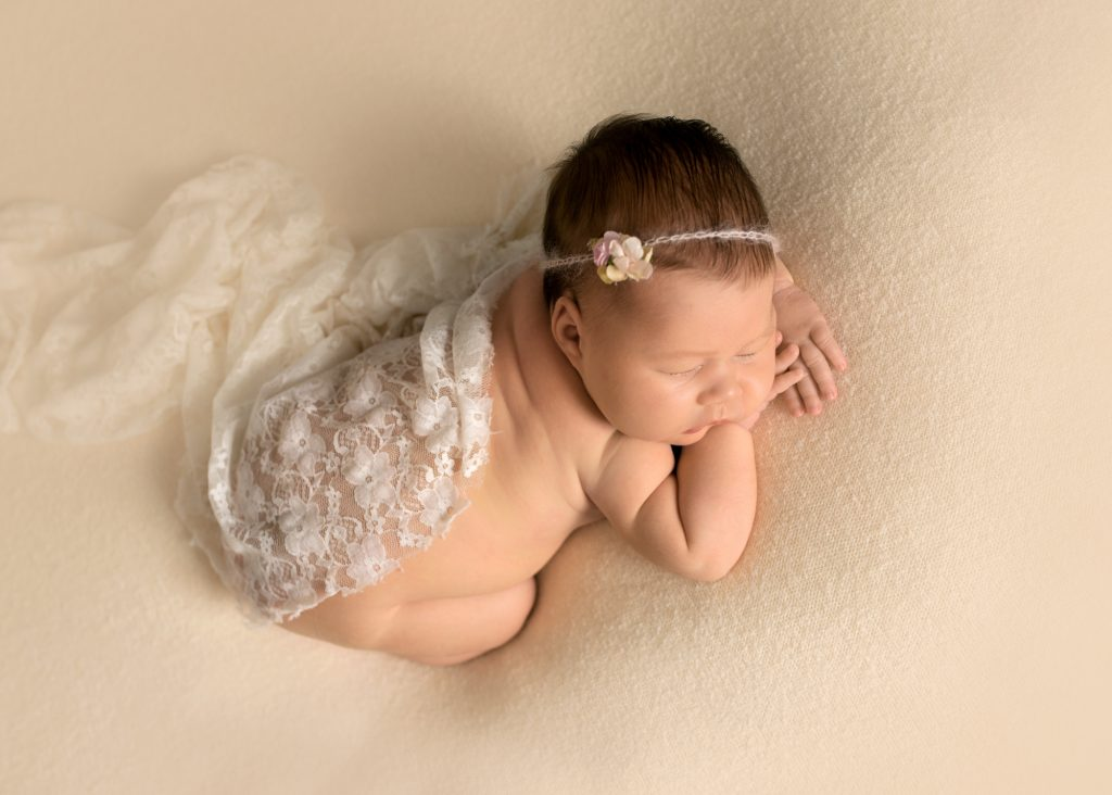 newborn girl with lace and flower headband