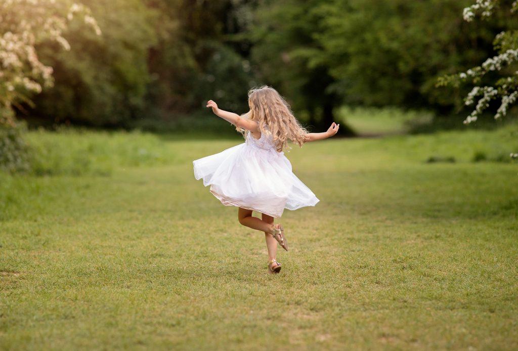 girl dancing in field