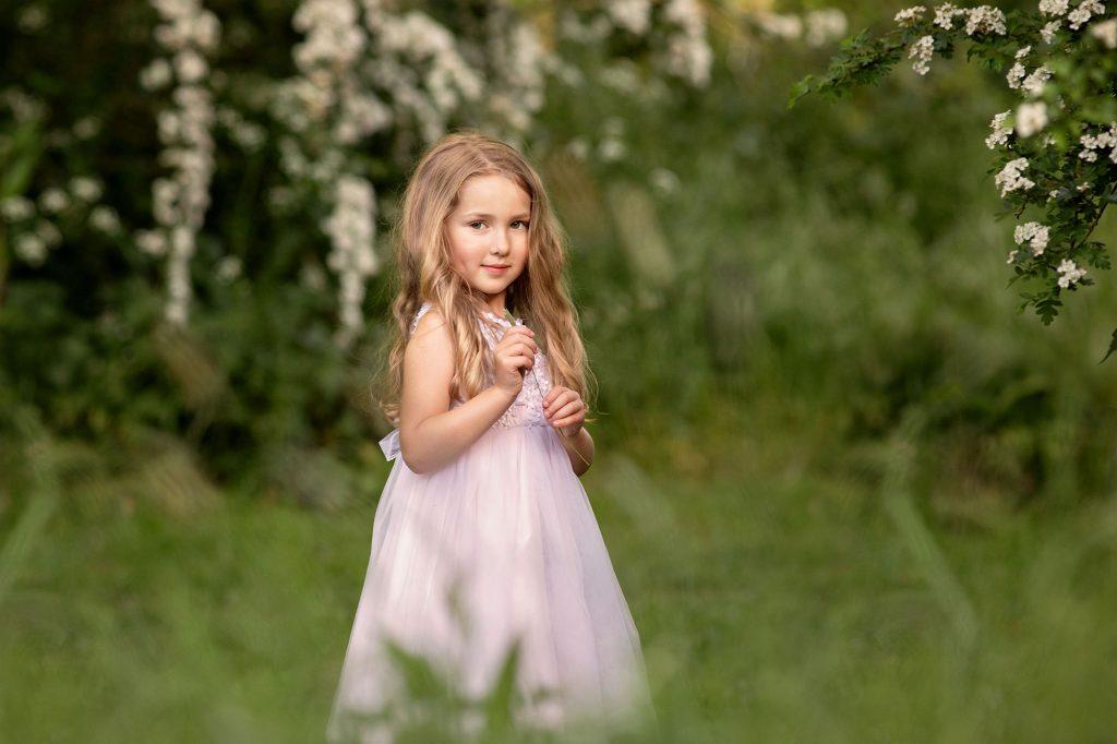 girl in blossom tree