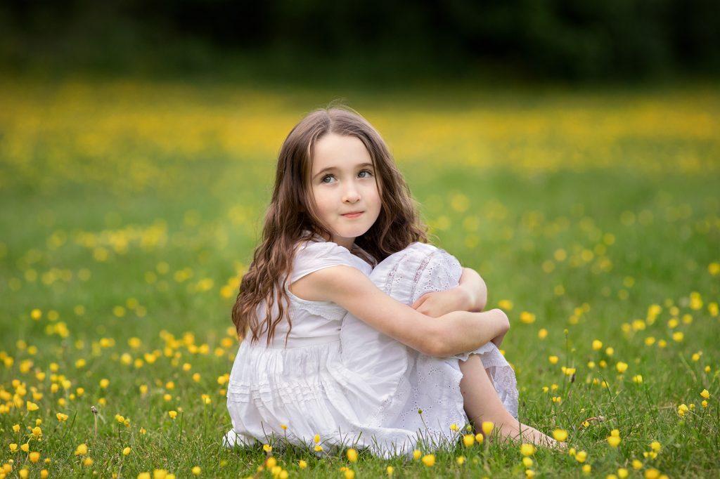 girl in buttercup field