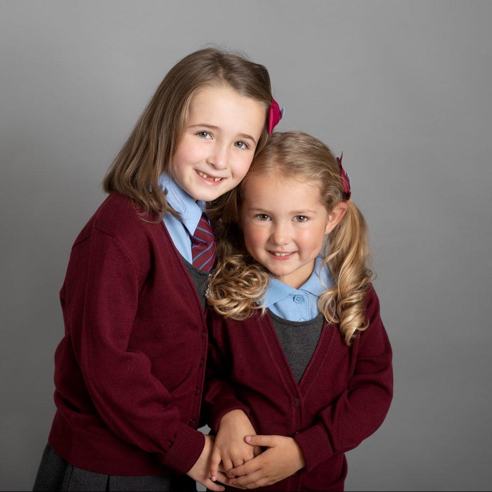 sisters wearing school uniform