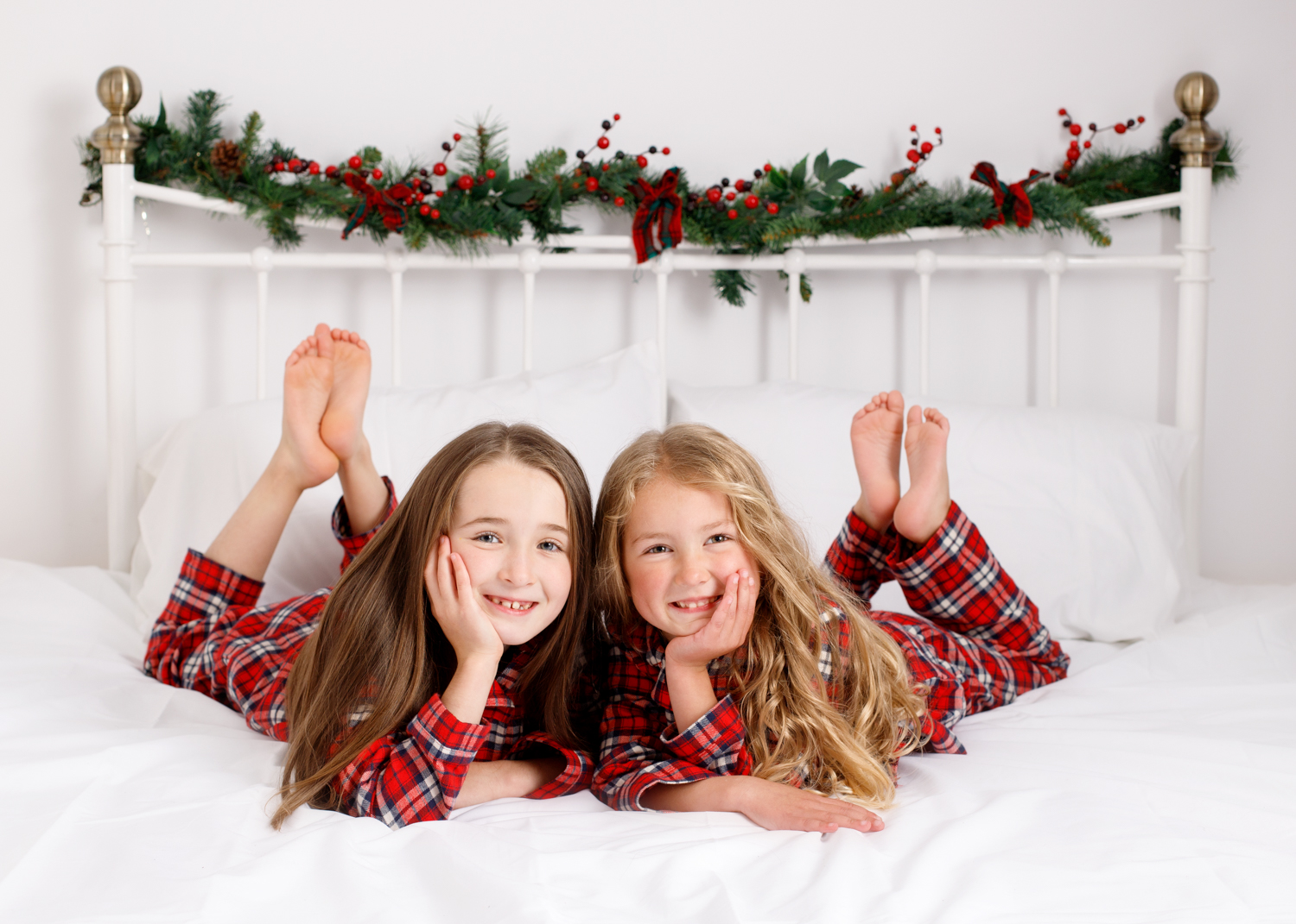 sisters in matching christmas pjs