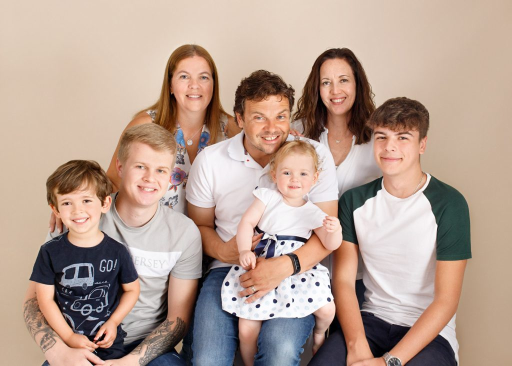 family smiling photographed in Kent