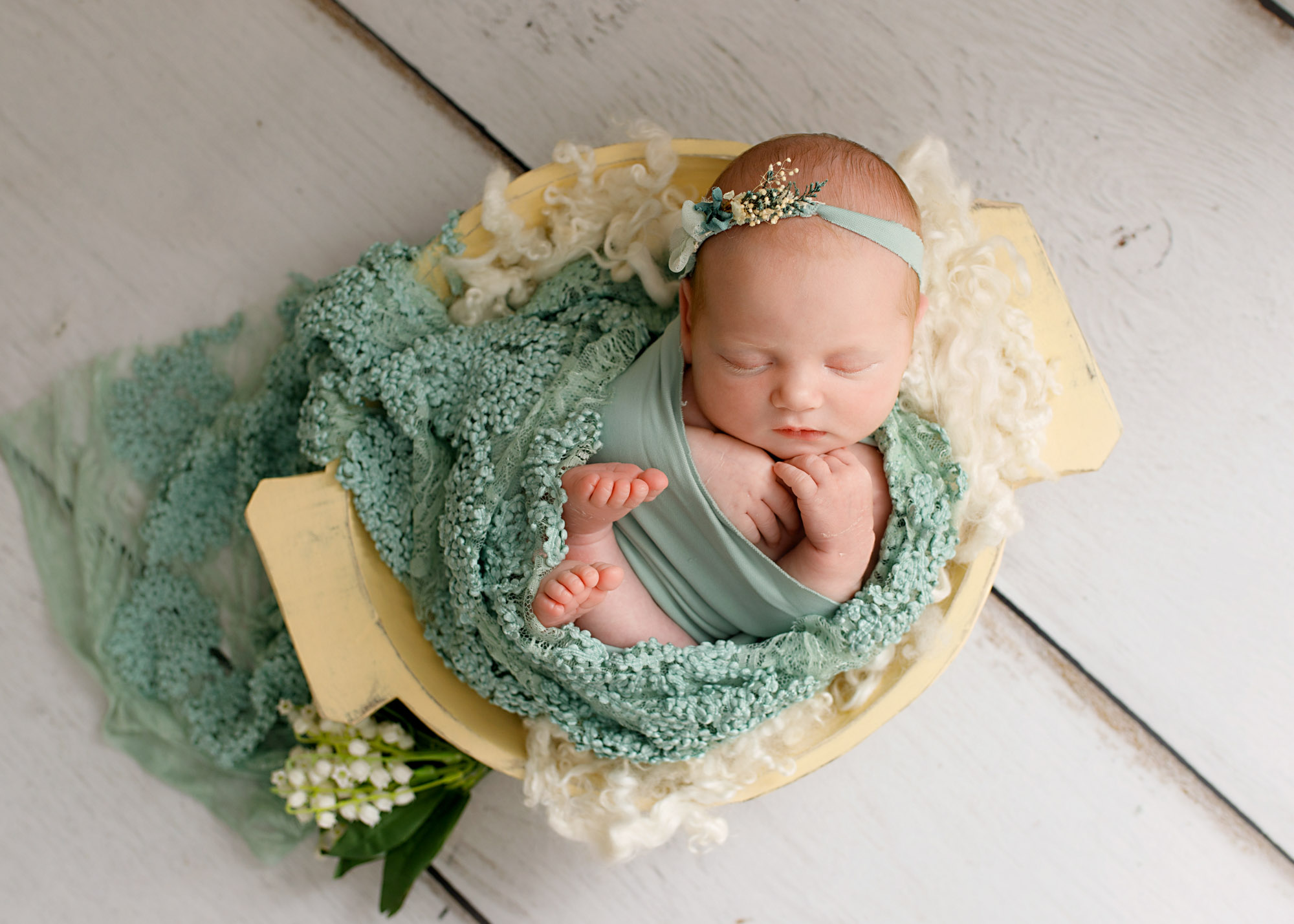 baby girls with green wrap in a bowl photographed in Kent