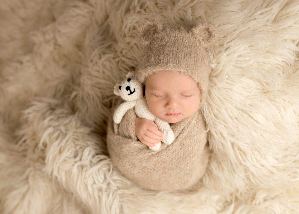 baby with bear bonnet and bear teddy