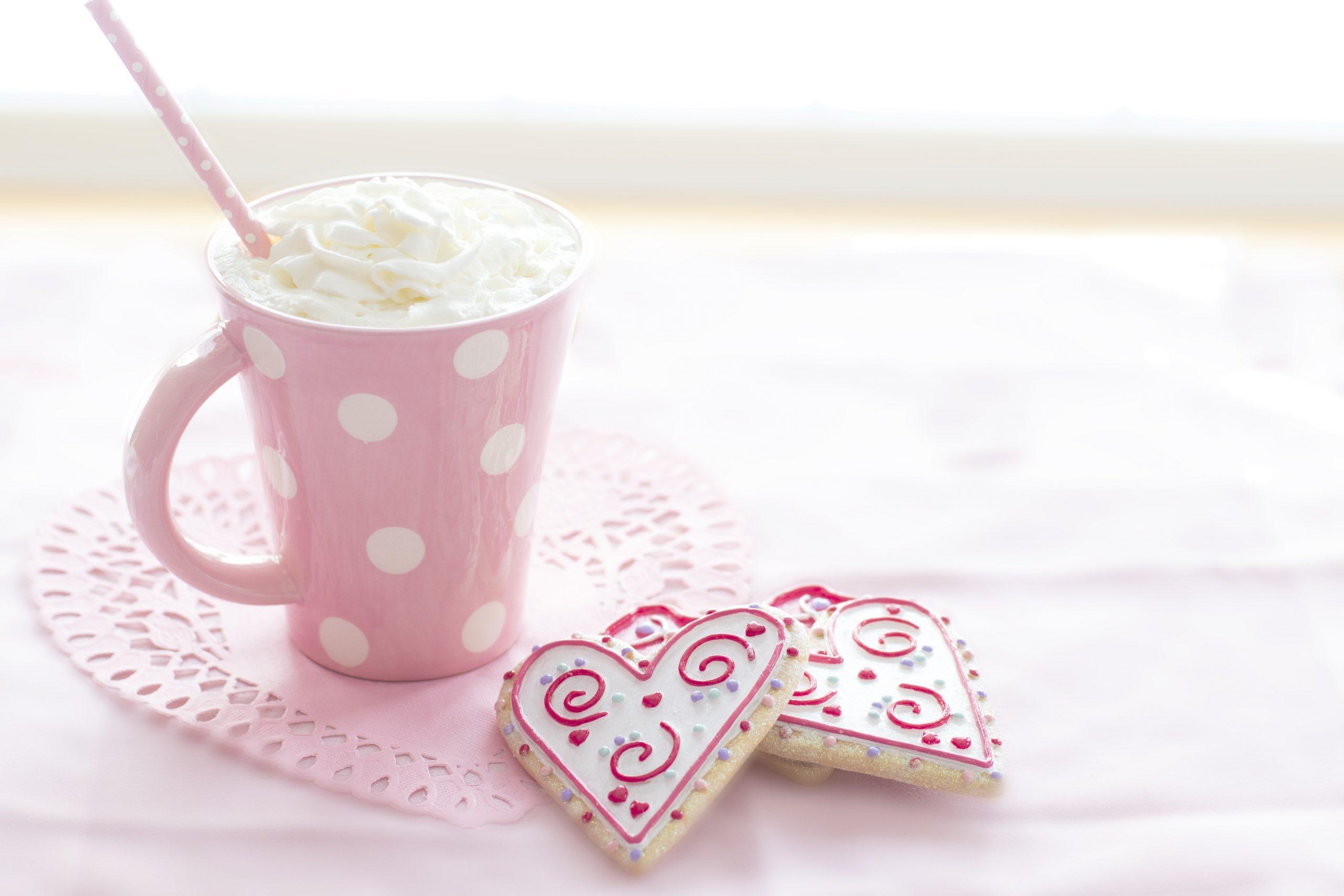 pink mug with hot chocolate band heart cookies